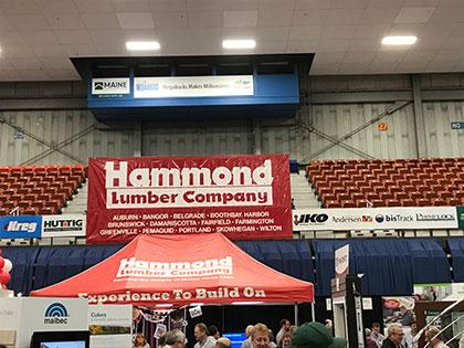 Hammond Lumber at trade show in augusta maine featuring Hallmark Floors