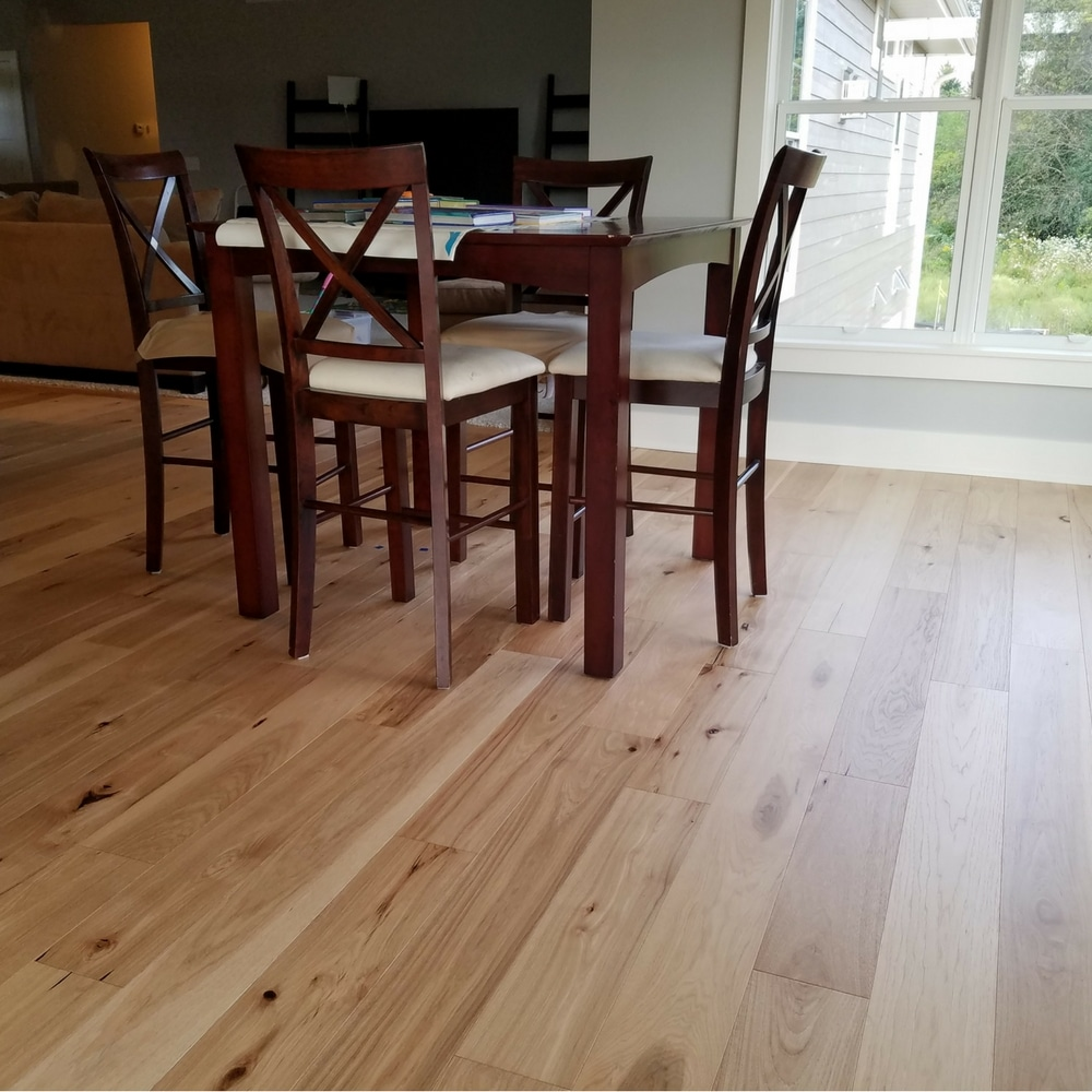small dining room table with engineered hickory plank flooring