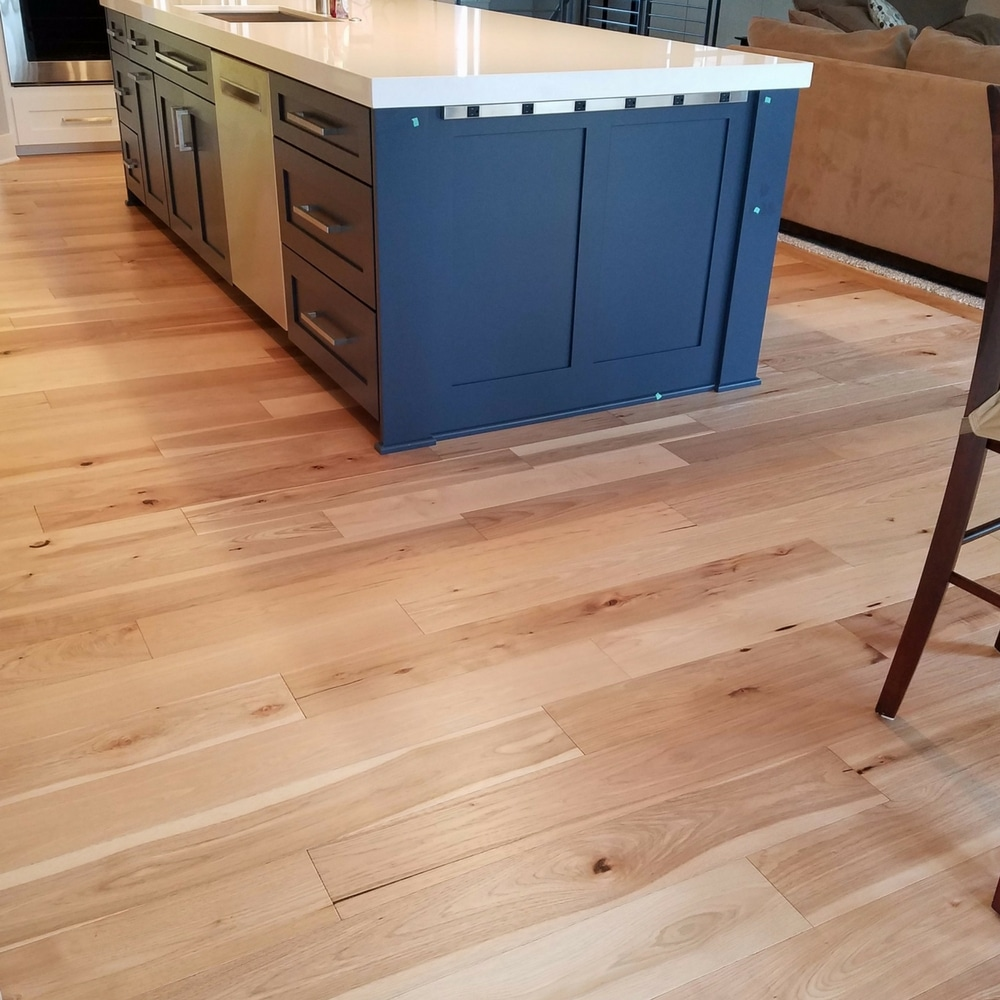 Blue cabinets with Hallmark Wide-Plank Hickory hardwood