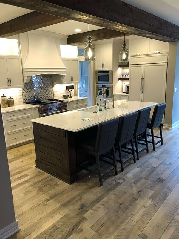 Contemporary rustic kitchen design with Cassia Maple, Organic wood flooring. Installed in a home in Omaha, NE. Organic wood floors by Hallmark Floors Inc.