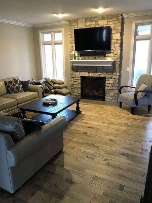 Cassia Maple, organic wood flooring, installed in a family room. in a home in Omaha, NE. Organic wood floors by Hallmark Floors Inc.