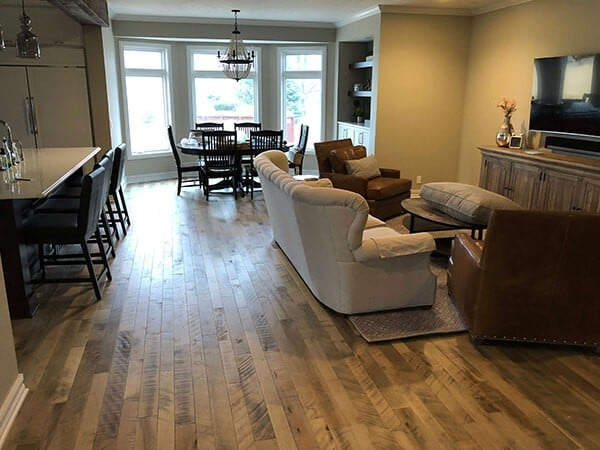 Cassia Maple wood floors installed in a great room in Omaha, NE. The remodel was completed by G. Lee Homes. The wood floors were installed by Gautsche and Sons LLC.