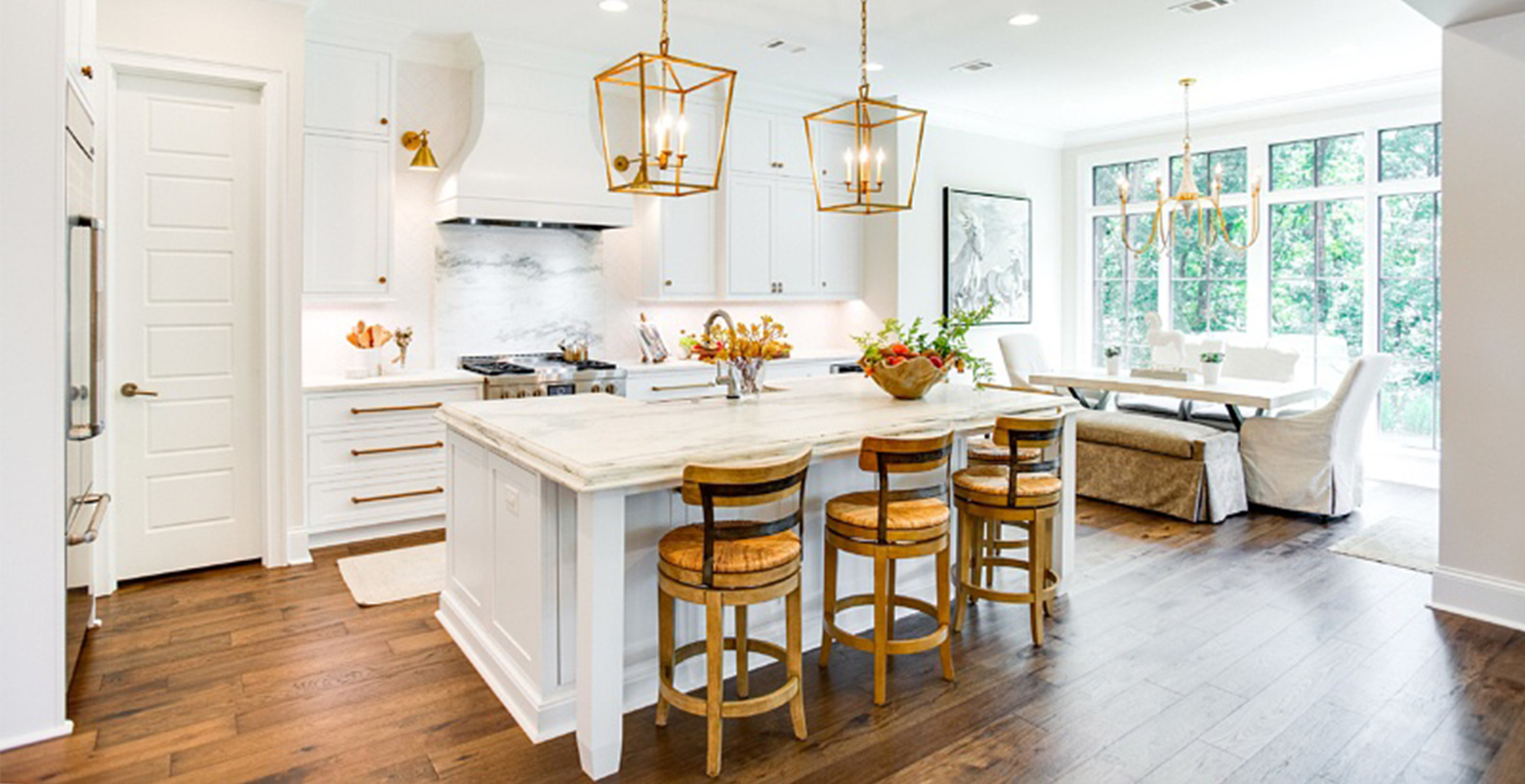 This image features Hallmark Floors' Novella - Eliot flooring. The kitchen and home was designed by Jay Younn of Toulmin Cabinetry