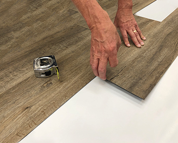 12mil vinyl Installation Demonstration by Hallmark Floors. Twelve Mil and Twenty Mil waterproof flooring is a glue down 12mil and 20mil vinyl floor.
