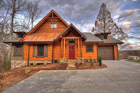 Modern cabin home in the woods of Ellijay Georgia. Dalton Wholesale Floors dealer in East Ellijay. Cabin facade in Ellijay Georgia. They sell beautiful Hallmark Floors' hardwood and waterproof flooring.