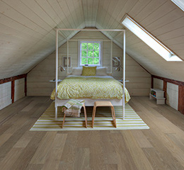Product Corral Maple, Chaparral flooring in a bedroom by Hallmark Floors.