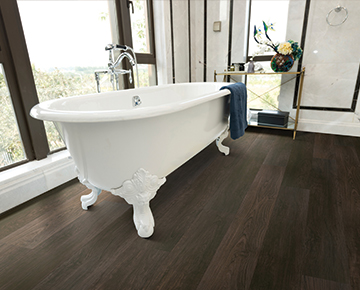 Margrave, Teak, from the Courtier commercial flooring collection installed in a bathroom.