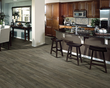 The flooring is Champlain Oak from the Polaris 12mil Waterproof flooring collection.