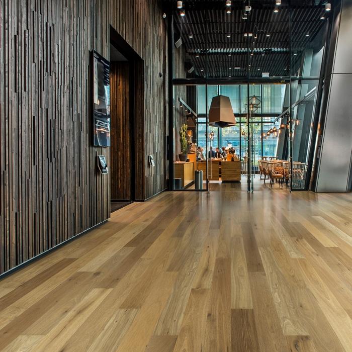 Sandal Oak hardwood flooring installed in a beautiful hotel lobby. Hallmark Commercial flooring.