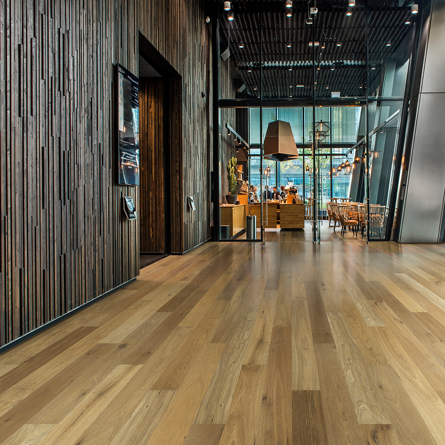 Sandal Oak hardwood flooring installed in a beautiful hotel lobby. Hallmark Commercial flooring.