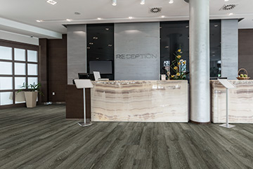 20 Mil waterproof commercial flooring from the 20 Mil vinyl collection by Hallmark Floors. Glue down waterproof vinyl flooring. Photo is of Oceanside 20mil commercial vinyl.