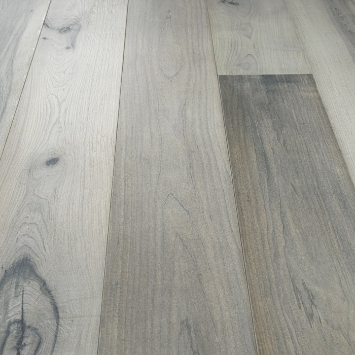 Juniper Maple Hardwood Floors from the True Hardwood Flooring Collection by Hallmark Floors. True Hardwood Flooring is an engineered wood floor where the color goes throughout the surface layer without using stains or dyes.