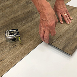 Times Square, 12mil and 20mil waterproof vinyl Installation demonstration by Hallmark Floors. Times Square, Twelve Mil and Twenty Mil waterproof flooring is a glue down 12mil and 20mil vinyl floor.