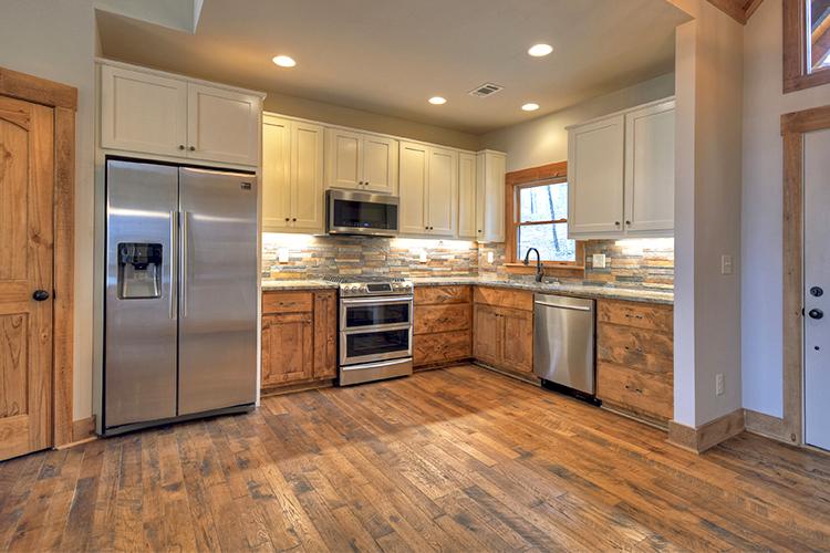 Hallmark Floors Organic Solid Tulsi Hickory cabin kitchen installation by Dalton Wholesale Flooring