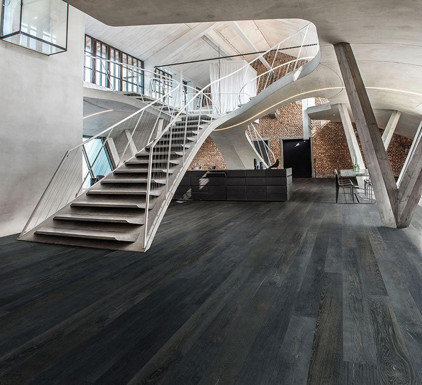 Onyx, Oak, Hardwood Commercial Flooring from the True Hardwood Flooring Collection by Hallmark Floors. True Hardwood flooring where the color goes throughout the surface layer without using stains or dyes.