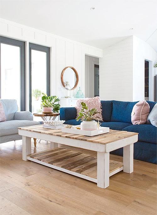 Farmhouse home decor with this beautiful coffee table. Farmhouse Design Inspiration with Michelle Wood and Hallmark Floors. Floors are Alta Vista hardwood flooring.