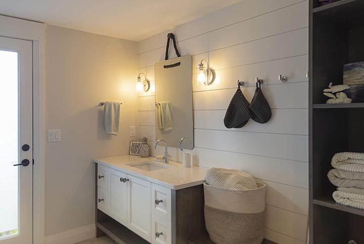 Modern Farmhouse renovation & design in a bathroom ship-lap walls.