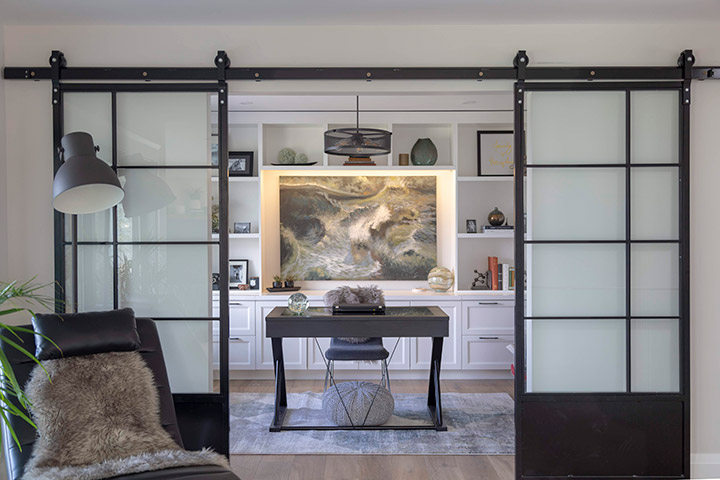 Modern Farmhouse Renovation with beautiful iron glass interior sliding doors and Alta Vista hardwood flooring!