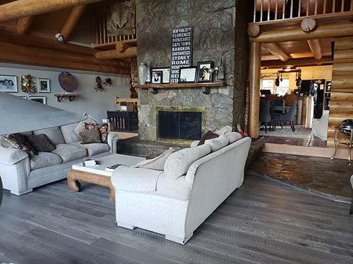 Floors in stalled in a living room in a log cabin home – Pekoe Oak Hardwood