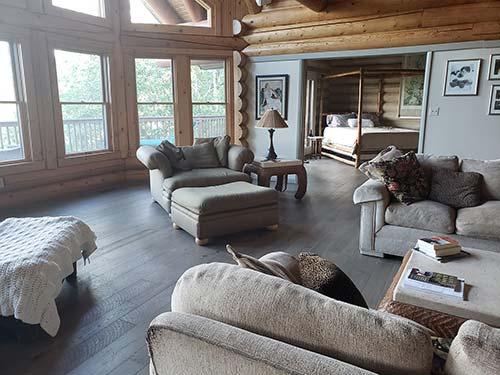 Log cabin home interior with Pekoe hardwood floors in a living room